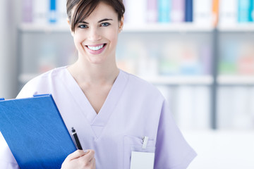 Smiling doctor holding medical reports