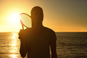 Composite image of female tennis player posing with racket