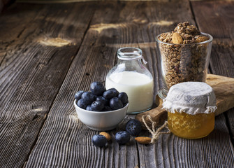 Healthy breakfast ingredients. Cereal, chocolate muesli, fresh blueberries