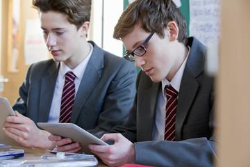 High school students using digital tablet in classroom