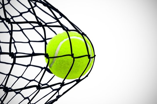Composite image of tennis ball with a syringe