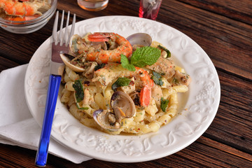pasta dish with fish and seafood