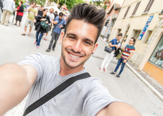 Handsome tourist taking a selfie