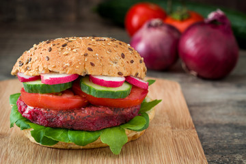 Veggie beet burger on rustic wooden table