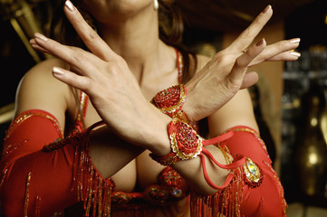 View of a young woman bellydancing