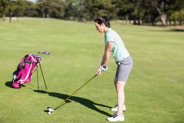 Side view of woman playing golf