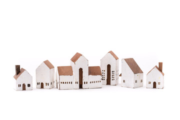 Miniature white wood house on white background