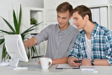portrait of handsome men with computer