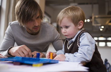 Father and young son coloring