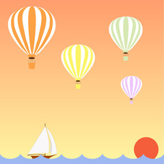 aerostats flying in sky over the sea at sunset, down sailing boat