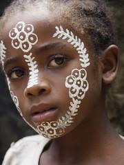 Girl with characteristical make-up at Nosy Komba, Madagascar