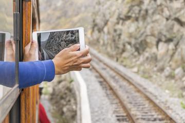 Person taking Photos at Touristic Train