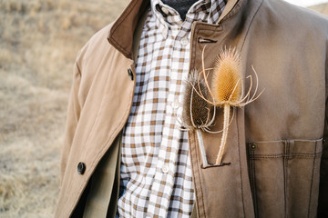 Cropped view of man with wildflower in buttonhole