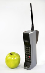 Apple and Brick Cell Phone.