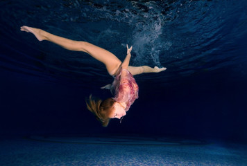 Woman presenting underwater fashion in pool