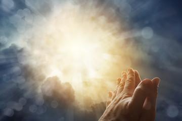Prayer hands and heaven sky