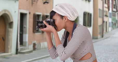 Woman with camera taking photo on Venice Italy city street