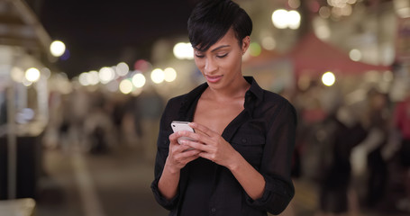Beautiful millennial woman using smartphone texting app and maki