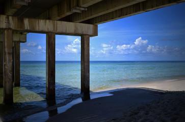 Under pier view of beach
