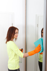 Pretty girl cleans bathrooms.