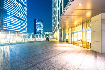 empty floor with modern office buildings in downtown of tokyo at