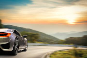 Brandless sport car drifting on the road under sunset.