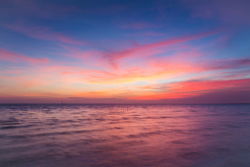 Seacoast skyline dramatic colours clouds after sunset, natural landscape background