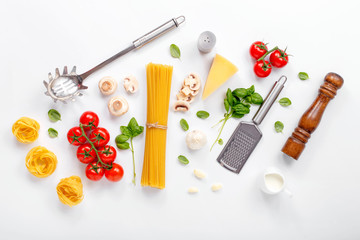 Fettuccine and spaghetti with ingredients for cooking pasta