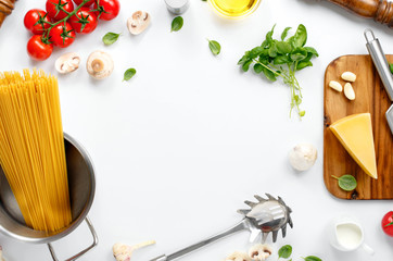 Frame with spaghetti and various ingredients for cooking pasta