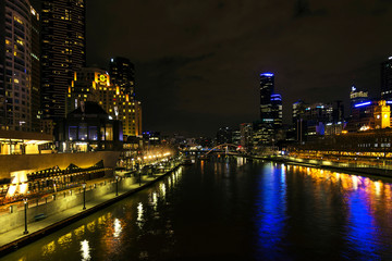 central melbourne city river side skyline at night in australia