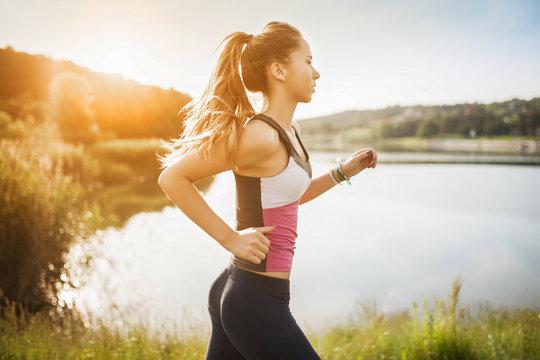 Beautiful young woman run in nature