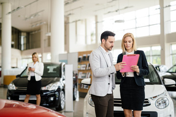Salesperson working at car dealership