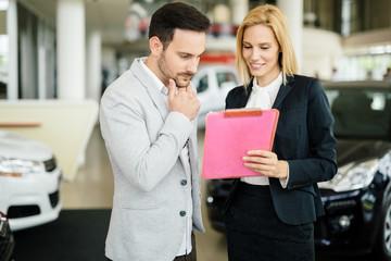 Customer looking for a car at dealership