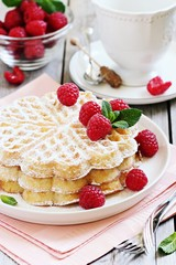 Homemade waffles with fresh raspberry.Selective focus
