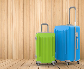 green and blue luggages on wooden background