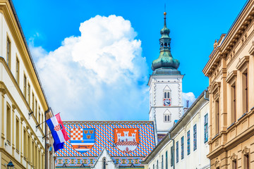 St. Mark's square Zagreb Croatia./ V iew at upper town of Zagreb, main national church roof with croatian emblems  and flag on St. Mark's square in Croatia, Europe. /