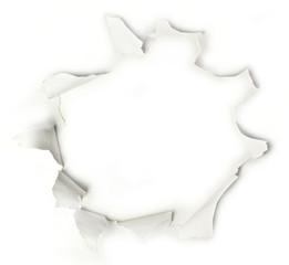 Hole in white paper sheet, with torn sides, with copyspace
