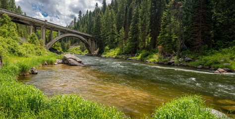 Idaho forest and river with a unique bridge