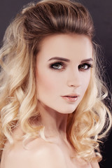 Beautiful Woman with Makeup and Wavy Permed Hair