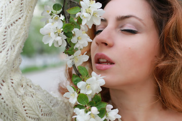 woman smell tree flower