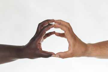 Interracial hands with fingers in contact. Equality concept