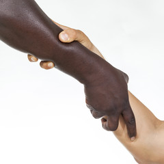 Interracial forearm shake,  helping , humanity and brotherhood concept. White background