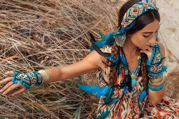attractive young woman in ethnic jewelry outdoors