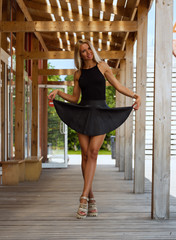 Beautiful girl in a short black skirt