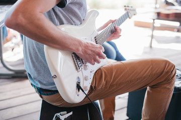 Man playing electric guitar. Subculture.