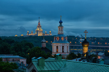 View to the observation deck of the Russian Academy of Sciences at the University of Moscow and St. Andrew's Monastery at night, Russia