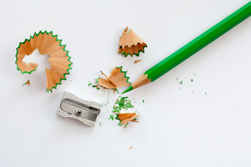 sharpener and green wooden pencil