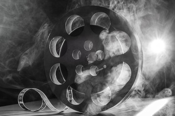 Reel of film retro in the smoke. black and white