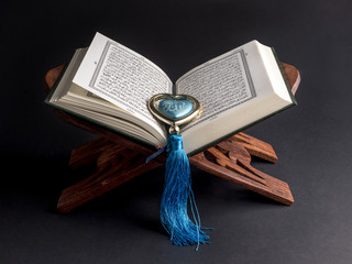 "Quran - holy book of Muslims with word in meaning ""Allah"""