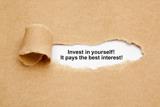 Invest In Yourself Quote Ripped Paper Concept